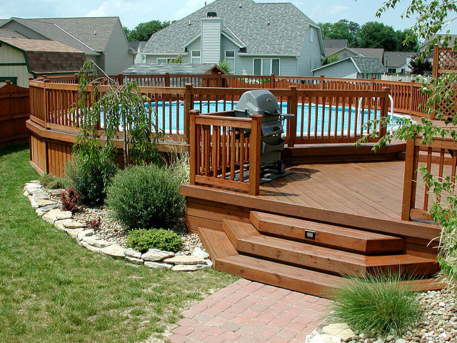 Above ground swimming pools from k built construction of for Above ground pool base ideas